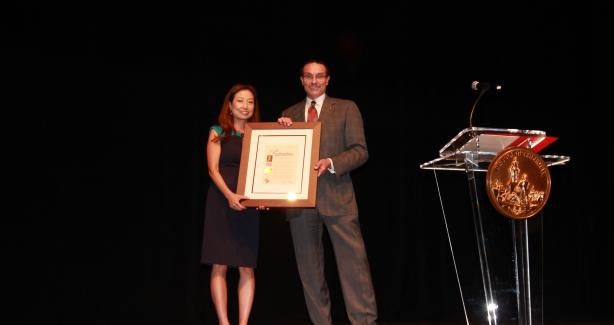 Mayor Gray presents OAPIA Director Julie Koo with proclamation
