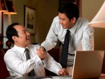 2 asian businessmen congratulating eachother