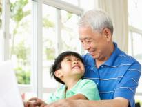 asian grandfather and grandson in living room